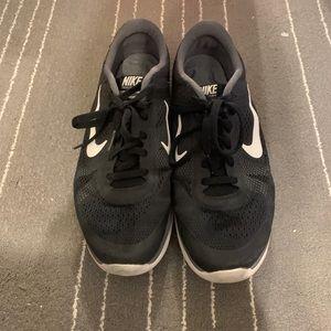 NIKE black running sneakers